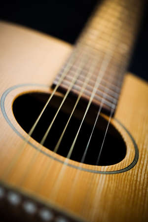 Acoustic guitar  Close-up on sound hole and neck  Very shallow depth of field and vignette Stock Photo - 17980323