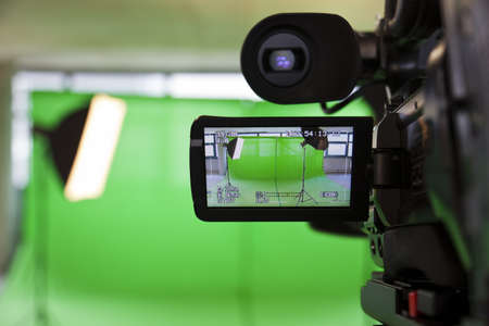 video camera: LCD display screen on a High Definition TV camera in a green screen studio