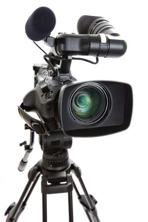 television camera: Close-up of a Digital HD Television Camera and Tripod isolated on a white background  Shallow depth of field with selective focus on lens  Stock Photo