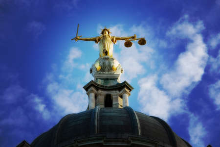 Lady justice on the top of the Old Bailey in London, England.