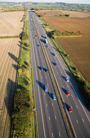 Aerial view of moving traffic on the M4 motorway in Somerset, England