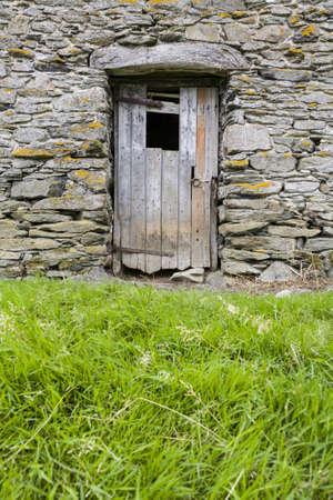 out of doors: Rustic wooden door on stone barn in Cumbria, England, UK
