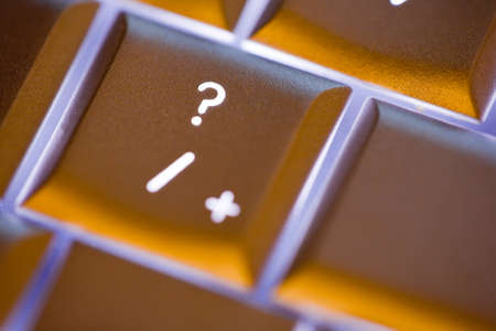 Close up of the question mark on an illuminated computer keyboard photo