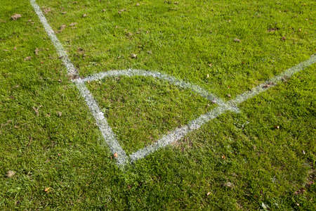 touchline: Close-up of the corner markings on a grassy football pitch