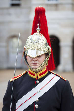 royals: Soldier of the Household Cavalry Mounted Regiment from the Blues and Royals Mounted Squadron stands guard outside Horse Guards Parade in London, United Kingdom on 4th Sept 2012