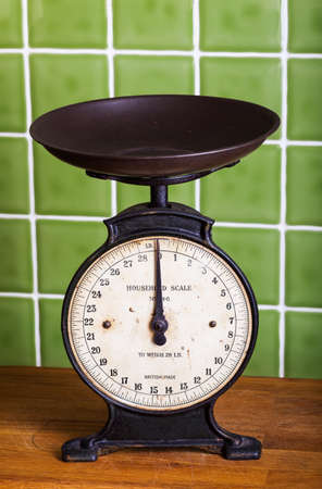 kitchen scale: Old mechanical Pan Scales in a Kitchen Stock Photo