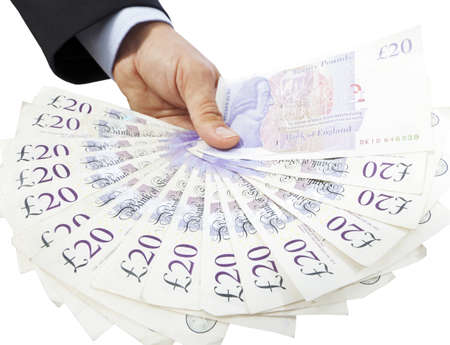 Close-up of a hand holding a fan of twenty pound notes against a white background  Stock Photo
