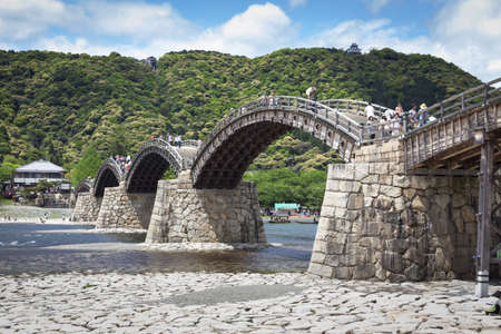 IWAKUNI, JAPAN - May 2012  Kintai Bridge spanning the Nishiki River in Iwakuni, Japan on 3rd May 2012  The 17th century wooden arch bridge is a popular attraction, giving access to Iwakuni Castle