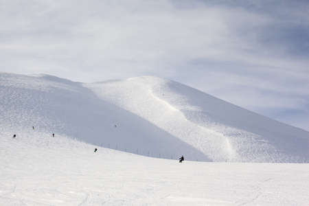 offpiste: General view of ski slopes on Mount Niseko Annupuri at the resort of Niseko in Japan  The view shows groomed piste in the foreground and off-piste powder on the mountain in the background  Stock Photo