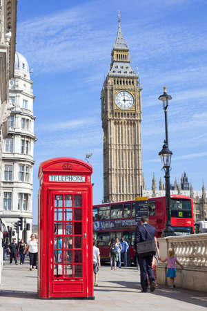 and distinctive: London, United Kingdom- September 4, 2012  General view of Great George Street in Westminster with people walking past a public telephone box, a red London bus and the distinctive tower of Big Ben out of focus in the background