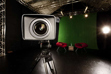 Close-up of a Television Camera lens in a green screen studio environment