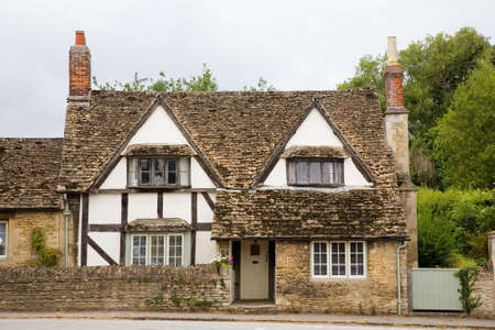 Old, traditional half timbered cottage in a village in Somerset, England, UK