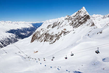 chair lift: Chair lift takes skiers up to Wurmkogl peak in the Hochgurgl area of the Otztal Alps in Austria  The distinctive peak of Schermerspitze can be seen behind