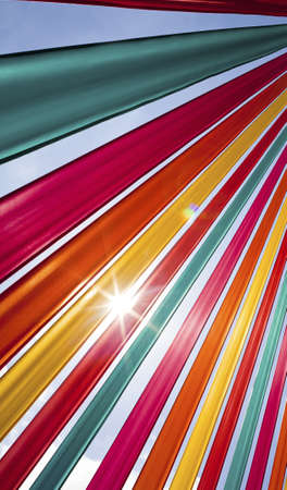 richly: Sunlight flares through richly coloured ribbons. Stock Photo