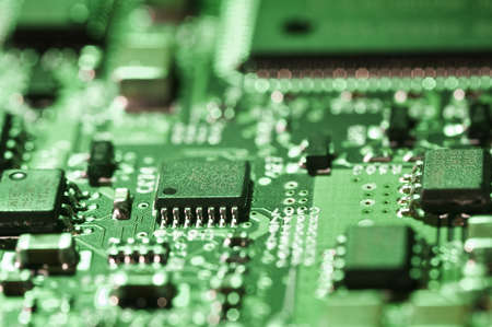 selective focus on microchips on a circuit board lit with green light Stock Photo - 18633476