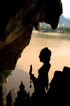 ou: Silhouette of Buddha statues Pak Ou Cave near Luang Prabang Laos. Stock Photo