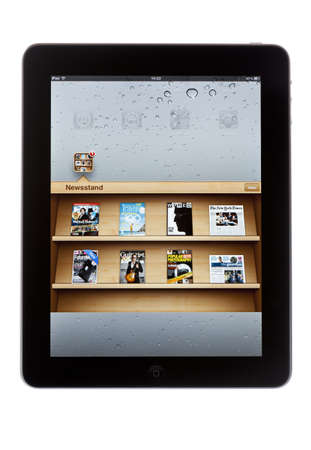 Bath, United Kingdom - November 8, 2011: An Apple iPad displaying the Newsstand application against a white background. Newsstand allows users to download iPad editions of newspapers and magazines. Editorial