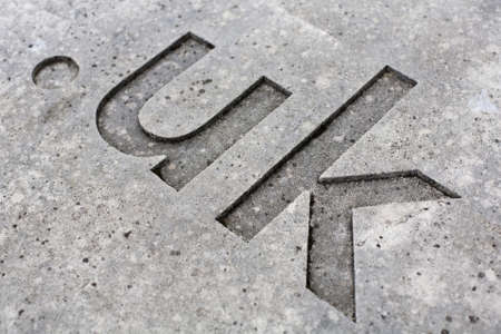 close-up of the   uk  internet country code for the UK carved into stone  Stock Photo - 18756826