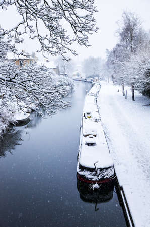 avon: Snowy view of the Kennet and Avon canal in Bath, England h a frozen, snow covered canal in Bath, England