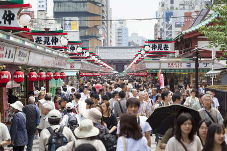 TOKYO - MAY 24  Nakamise shopping street in Asakusa, Tokyo packed with tourists on 24th May 2012  The busy arcade connects Senso-ji Temple to it