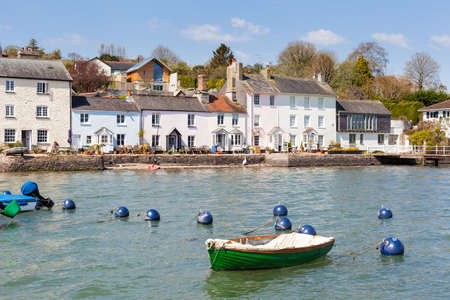 Row of traditional cottages line the edge of the River Dart at Dittisham in South Devon, England Stock Photo