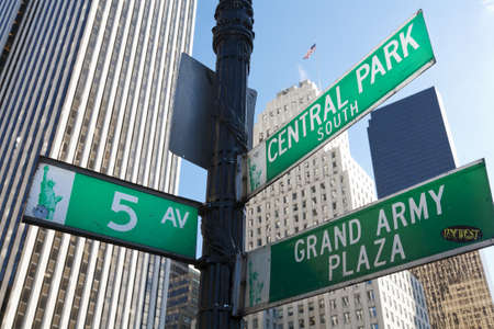 central park: New York City, United States - September, 19 2008: Manhattan street signs near Central Park, with skyscrapers behind.