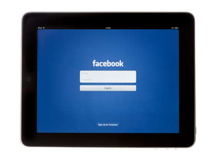 facebook: Bath, United Kingdom - November 9, 2011: An Apple iPad showing the log in screen of the Facebook App, shot against a white background. The social media application is used to connect with friends and contacts online.
