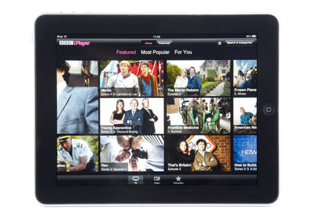 programmes: Bath, United Kingdom - December 2, 2011: An Apple iPad displaying the front page of the BBC iPlayer app, against a white background. The app can be used to select and watch recent BBC television programmes. Editorial