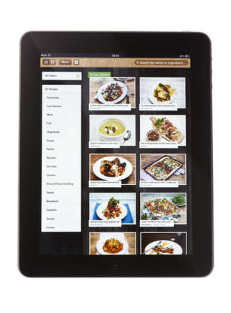 Bath, United Kingdom - November 9, 2011: An Apple iPad, against a white background, displaying the Jamie Oliver recipe app. Illustrated recipes by the British chef can be downloaded and have step-by-step instructions, photos and audio tips.