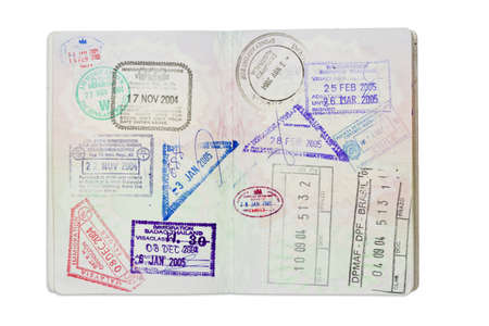 Inside of a well travelled UK Passport, isolated against white with clipping path.