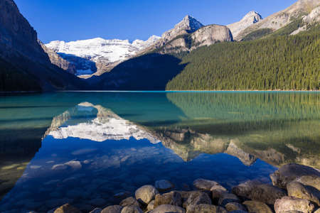 Mount Victoria and Glacier reflected in the colourful water of Lake Louise, Alberta, Canada Stock Photo