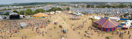 GLASTONBURY, UK - JUNE 25 : Panoramic view of the festival site at Glastonbury, UK on 25th June 2010. Taken from the Ribbon Tower in the Park Stage area. The three day event is the world's largest music and performing arts festival.