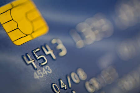 Credit card close-up with selective focus at the start of the card numbers
