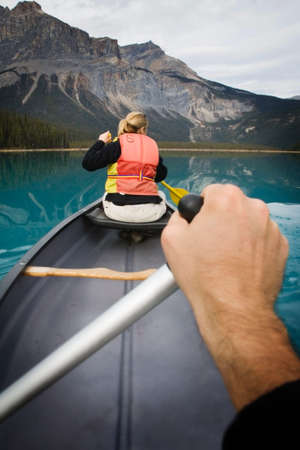 Point of view paddling a canoe gently on Emerald lake in Yoho National Park, British Columbia, Canada