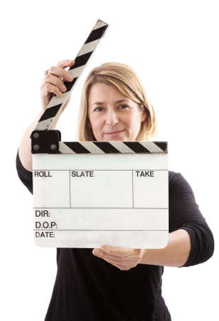 Woman holding an open film clapper board  Stock Photo