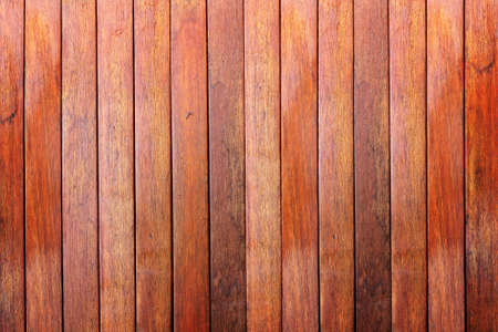 Wooden wall background made with vertical planks of hardwood photo
