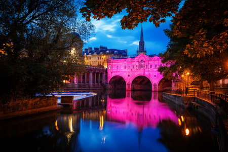 weir: Pulteney Bridge in Bath at night with colourful lighting