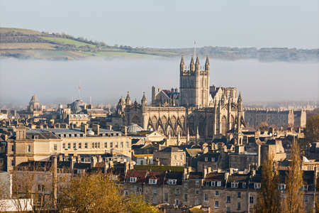 The historic city of Bath shrouded in mist on an autumn morning photo