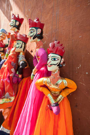 puppetry: Indian string puppets hanging by a wall. The puppets are used in traditional Rajasthani Theatre called Kathputli.