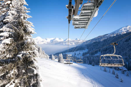 soleil: View down the valley from a chair lift in Les Gets ski resort, Portes Du Soleil, France