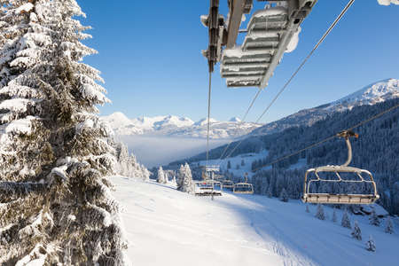 gets: View down the valley from a chair lift in Les Gets ski resort, Portes Du Soleil, France
