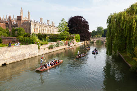 punter: CAMBRIDGE, UK - JUNE 12, 2015 : People in punts on the river Cam  with Clare College and Clare Bridge in the background Editorial