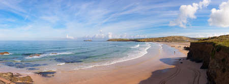 sandy beach: Gwithian Beach and Godrevy Lighthouse in Cornwall, UK Stock Photo