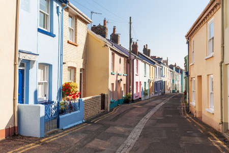 neighbours: Multi-Coloured, Terraced Houses on a Street in Appledore, North Devon, UK
