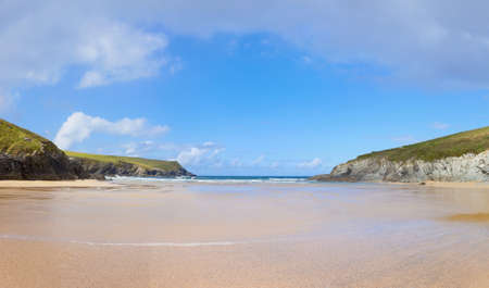 away from it all: Wide Empty Beach at Porth Joke in Cornwall, UK.