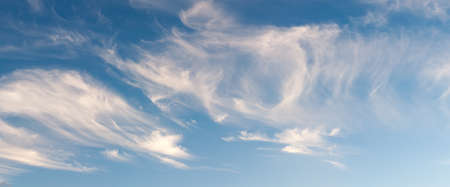 wispy: Panoramic view of wispy cirrus clouds on an autumn evening