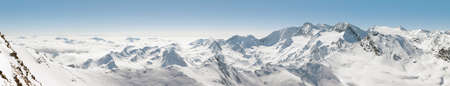 cloud capped: Panoramic View of the Alps in Austria Stock Photo