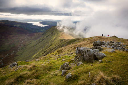 View of Rydal Fell and Lake Windermere from the top of Great Rigg on the Fairfield Horseshoe in Cumbria, UK Stock Photo