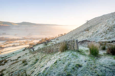 Dry stone wall on a frosty morning at Cracken Edge in the High Peak District, England