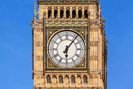 Close up of the clock face of Big Ben in Westminster, London on a clear sunny day. Editorial